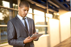 Successful business man with digital tablet outside Royalty Free Stock Photo