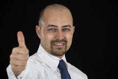Successful business man holding thumb up Royalty Free Stock Images