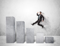 Successful business man jumping over charts on background Stock Images