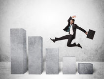 Successful business man jumping over charts on background Royalty Free Stock Photo