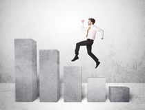 Successful business man jumping over charts on background Stock Photography