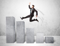 Successful business man jumping over charts on background Royalty Free Stock Photography