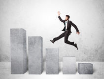 Successful business man jumping over charts on background Royalty Free Stock Images
