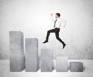 Successful business man jumping over charts on background Stock Photos