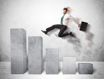 Successful business man jumping over charts on background Royalty Free Stock Photos