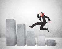 Successful business man jumping over charts on background Stock Image
