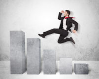 Successful business man jumping over charts on background Royalty Free Stock Image