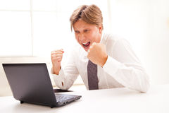 Successful business man with laptop isolated Royalty Free Stock Photo