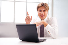 Successful business man with laptop isolated Stock Image