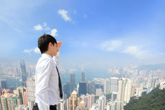 Successful business man looking away with city Stock Photo
