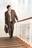 Successful business man moving up Stock Photos