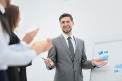 Successful business man at the office leading a group. Business people clapping at conference Royalty Free Stock Photo