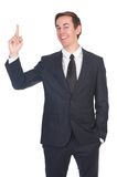 Successful business man pointing finger Royalty Free Stock Photos