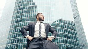 Successful business man rejoicing in victory raising hands up in a modern city.  stock footage