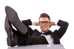 Successful business man relaxing stock images