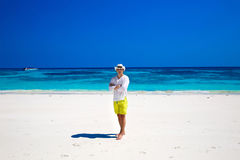 Successful business man resing on tropical beach island backgrou Royalty Free Stock Photo