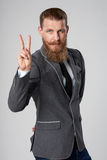 Successful business man showing V sign Royalty Free Stock Photo