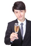 Successful business man toasting with Champagne Royalty Free Stock Photography
