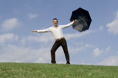 Successful business man with umbrella. Successful business man. concept of insurance and coverage Stock Photo