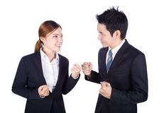 Successful business man and woman with arm raised isolated on wh royalty free stock photography