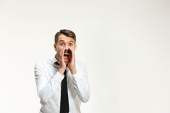 Successful business mane crying on white. Background. Listening, Shouting concept Royalty Free Stock Image