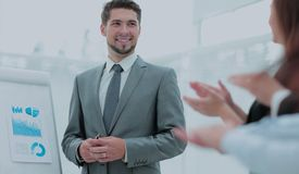 Business people clapping at conference. Business presentation. Successful business men in suit at the office leading a group Stock Photo