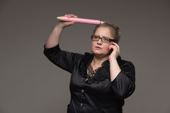 Successful business middle-aged woman with glasses talking on th Royalty Free Stock Photography