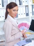 Successful business owner showing off her wealth Stock Photo