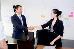 successful business partner shaking hands after with meeting. Stock Image