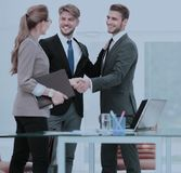 Business people shaking hands, finishing up a meeting Royalty Free Stock Photo