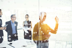 Successful business partners in work. Afro american female leader working with colleagues motivated them for collaboration pointing out main ideas noting on royalty free stock photos