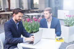 Successful business partners are working in cafe Stock Images