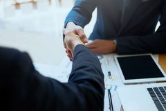 Successful business peolple handshaking after good deal. Stock Photo