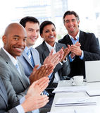 Successful business people applauding. Team of successful multi-ethnic business people applauding in a conference Royalty Free Stock Images
