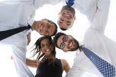 Successful business people with arms around each other`s shoulders. Stock Image
