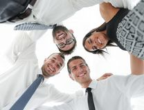 Successful business people with arms around each other`s shoulders. Stock Photo