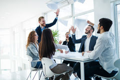 Successful business people celebrating achieved business goals. Successful business colleagues celebrating achieved business goals Royalty Free Stock Images