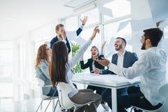 Successful business people celebrating achieved business goals. Successful business colleagues celebrating achieved business goals Stock Photography