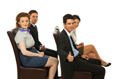 Successful business people on chairs Stock Image