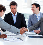 Successful business people closing a deal. Close-up of successful business people closing a deal in a meeting Stock Image