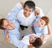 Successful business people forming a huddle Royalty Free Stock Image