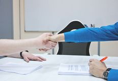 Successful business people handshaking after good deal. royalty free stock photos