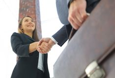 Close up of businessman and businesswoman shaking hands Stock Photos