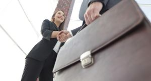 Close up of businessman and businesswoman shaking hands Royalty Free Stock Image