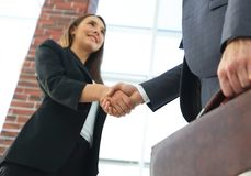 Close up of businessman and businesswoman shaking hands Stock Photo