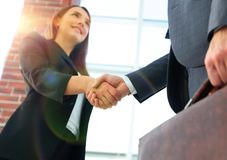 Close up of businessman and businesswoman shaking hands Stock Image