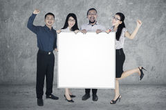 Successful business people hold whiteboard Stock Photos
