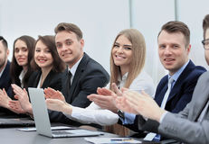 Successful business people looking happy and confident. Of happy  people applauding at conference Stock Photo