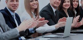 Successful business people looking happy and confident. Photo of happy business people applauding at conference Stock Photo