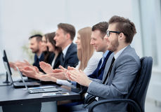 Successful business people looking happy and confident. Photo of happy business people applauding at conference Royalty Free Stock Photos